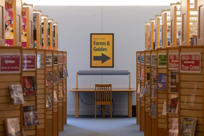 """A """"Forms & Guides"""" sign posted in the west wing of the Topeka and Shawnee County Public Library directs visitors toward a new hub for information the library's business and career team recently stood up."""
