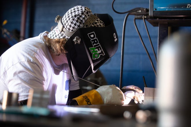 Tanner Ham, student at Washburn Tech, practices TIG welds Wednesday at Washburn Tech. Community and technical colleges statewide have said they've seen an enrollment bump, defying national trends.