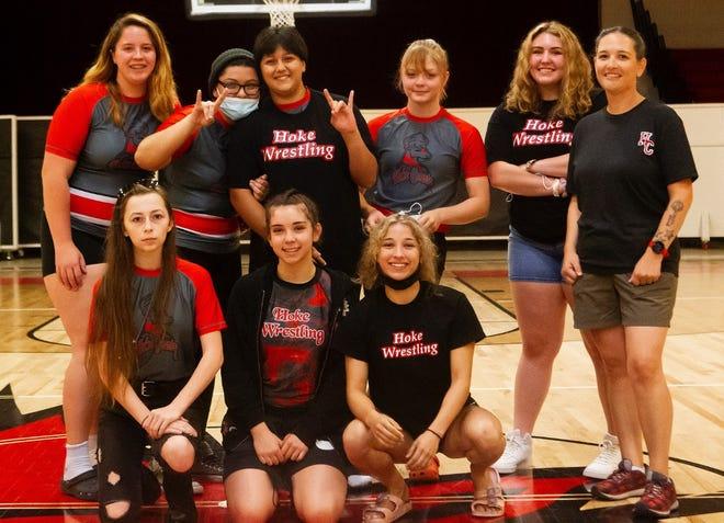 The Hoke County High girls' wrestling team: back row, from left, Piper Hill, Isabella Kessey, Gabriella Kessey, Milena Daniels, Samantha Kidder, coach Rachel Borman. Front row, from left, Angelina Kulczewski, Maia Kaleo and Laila Sa.