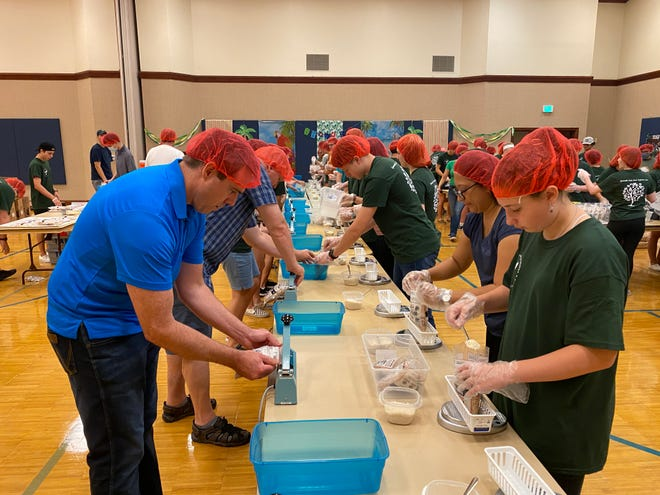 Meals being put together at Gainesville Church of Jesus Christ-Latter Day Saints