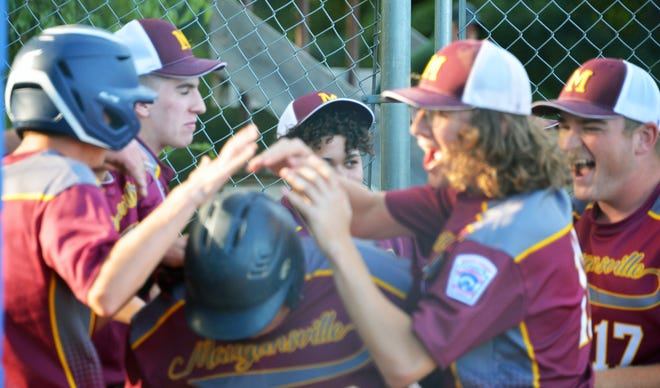 Mauganville's Jay Hawks (center) travels through the gauntlet of a hero's welcome after hitting a two-run home run in the fourth inning of a 2-0 win over Conococheague in a Maryland District 1 Senior League Tournament championship round game Friday.