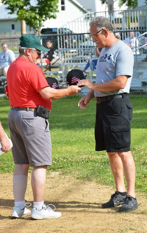 Doug Higgins receives a commemorative cap for being a part of the 1971 Hagerstown Colt League All-Stars who won the World Series. Higgins was one of 10 members of the team to return for the anniversary ceremony at Hellane Park. Higgins is writing a book about the team's championship adventure.
