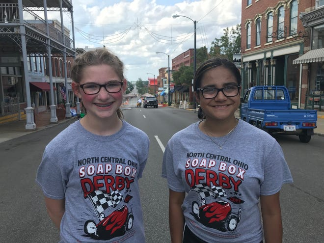 North Central Ohio Soap Box Derby winners are: Stock winner Autumn Stechschulte, 11, of Columbus Grove, at left, and Ava Gayton, 12, of Mount Gilead, the super stock champion. They will now compete in Akron.
