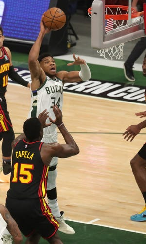 Giannis Antetokounmpo makes a shot during Game 2 of the Eastern Conference finals against the Atlanta Hawks.