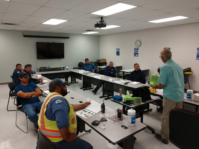 Las Cruces Utilities employees receiving training from a Staking University instructor to certify as underground utility locators.