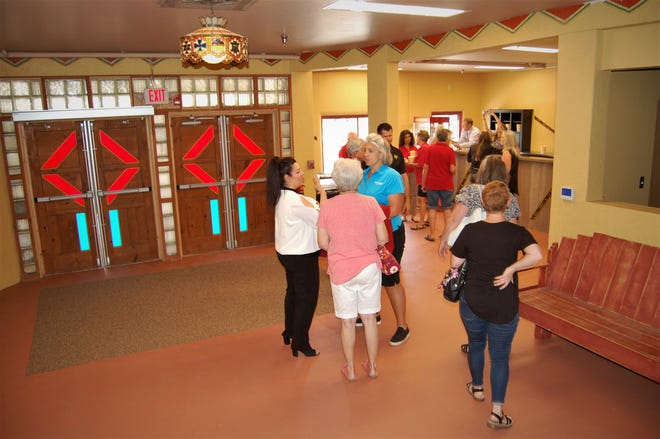 Visitors to the newly renovated Totah Theater in downtown Farmington gather in the lobby after a ribbon-cutting ceremony on June 24.