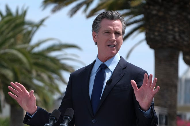 In this Tuesday, June 15, 2021, file photo, California Gov. Gavin Newsom talks during a news conference at Universal Studios in Universal City, Calif. California Gov. Gavin Newsom and the state's two top legislative leaders moved closer to approving a final operating budget on Friday, June 25, 2021 with lawmakers filing a massive bill that represents a broad agreement among the three parties but with some important details unfinished.