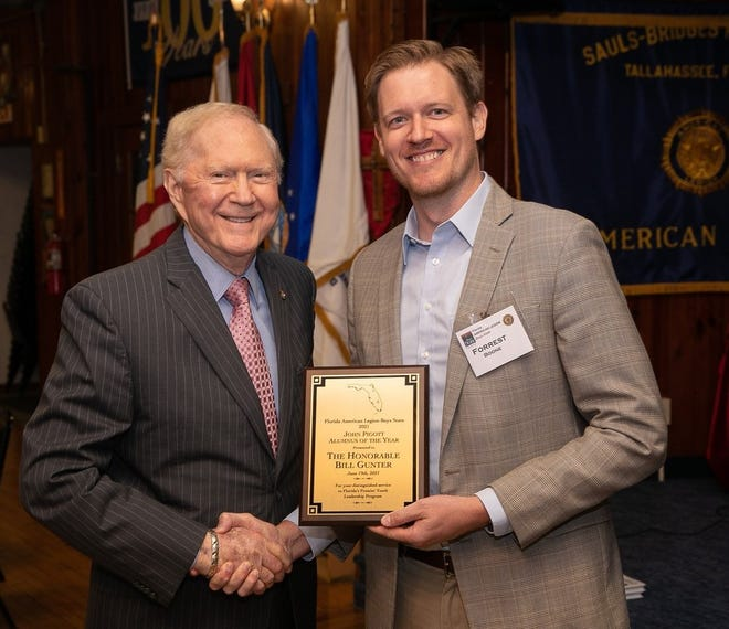 Bill Gunter, left, receiving the American Legion Boys State Distinguished Alumnus Award from Forrest Boone, Boys State Director.