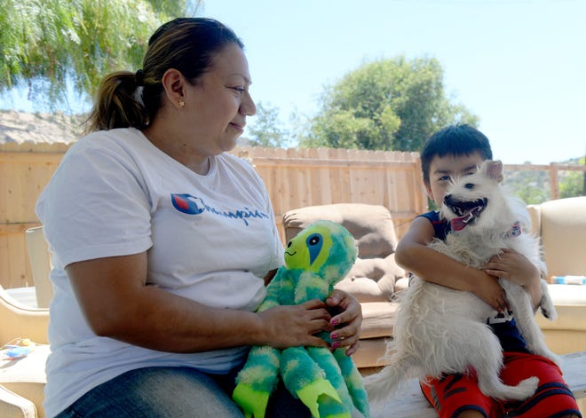 Iris Alvarado, at home with her son, Junior Tucux, in Simi Valley on Friday, said she has yet to hear back from the state on her application for rent relief that she submitted three months ago. Alvarado lost her job cleaning a Calabasas nursing home in February 2020 at the onset of the COVID-19 pandemic.