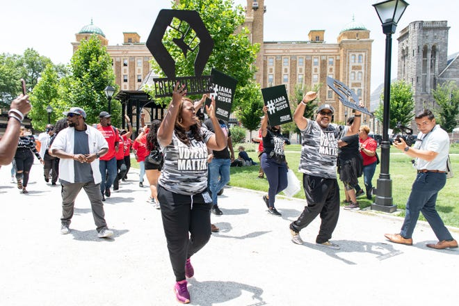Voter rights activists, led by LaTosha Brown and Cliff Albright, co-founders of Black Voters Matter, arrived at Monroe Park in Richmond, Va., on June 25, 2021, as part of the voting rights group's bus tour marking the 60th anniversary of the Freedom Rides.