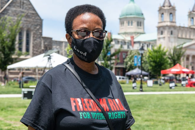 """Brenda Wright, who joined a rally hosted by Black Voters Matter in Richmond, Va., June 25, 2021, said it was important to show supportfor the campaign to protect voting rights.  """"There's power when we come together,'' said Wright, who moved two years ago from Jackson, Miss. """"I believe in voting rights for everybody. You see all that's going on. They're trying to block Black folks from voting."""""""