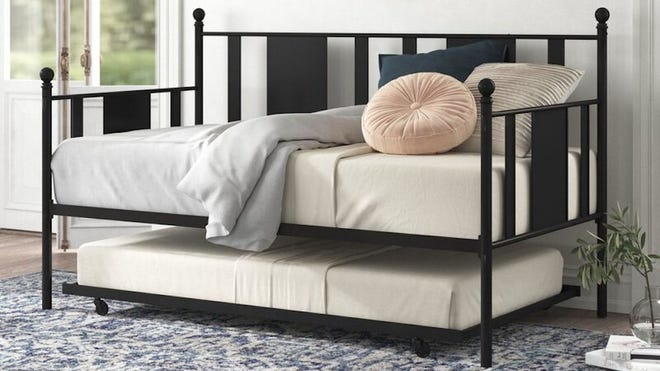This elegant bed with casters gives any room a luxurious feel.
