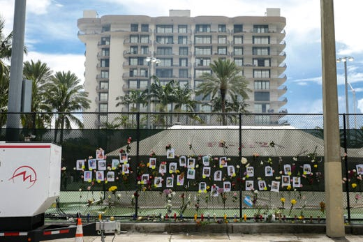A view of a make-shift memorial near the site where a 12-story building partially collapsed in the community of Surfside, Florida on June 26, 2021.