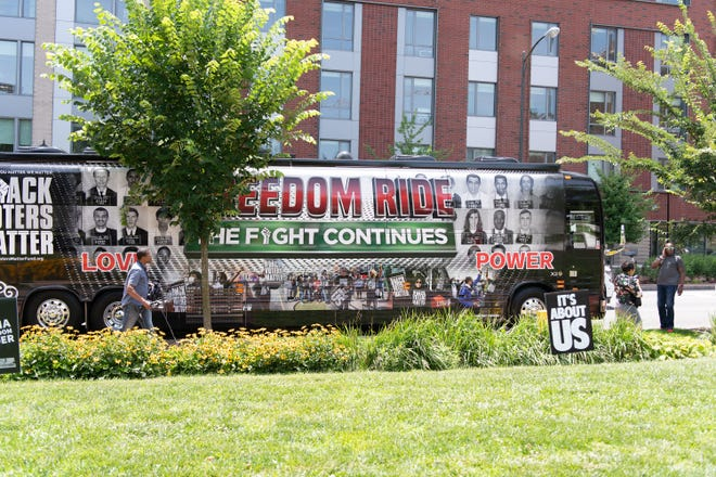 A bus carrying voter rights activists arrives in Monroe Park in Richmond, Va., on June 25, 2021, as part of a bus tour marking the 60th anniversary of the Freedom Ride and the eighth anniversary of the Shelby County v. Holder Supreme Court decision, which struck down core parts of the Voting Rights Act of 1965.