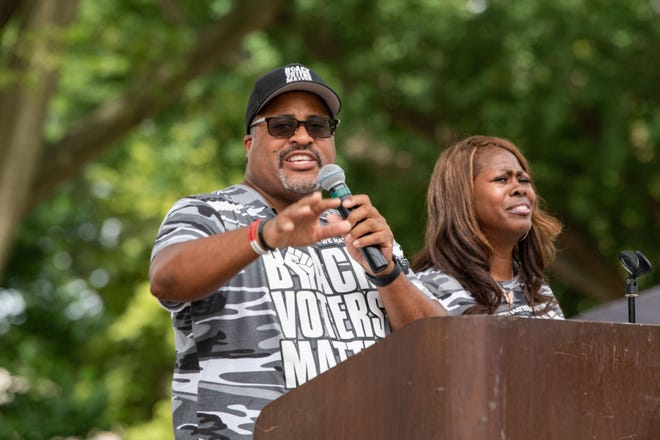 Cliff Albright and LaTosha Brown, co-founders of Black Voters Matter, urge the crowd at a rally in Monroe Park in Richmond, Va., June 25, 2021, to call on Congress to support federal voting rights bills and push back against states adopting restrictive elections laws.