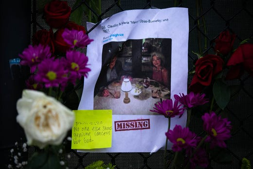 Photos of missing residents are posted at a makeshift memorial at the site of a collapsed building in Surfside, Florida, north of Miami Beach,on June 26, 2021.