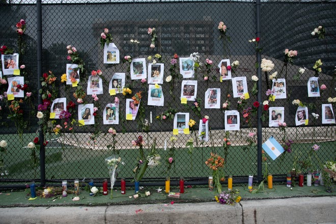 A memorial honoring those unaccounted for after a 12-story building collapsed on display near the collapse site in Surfside, Fla. on June 26, 2021.
