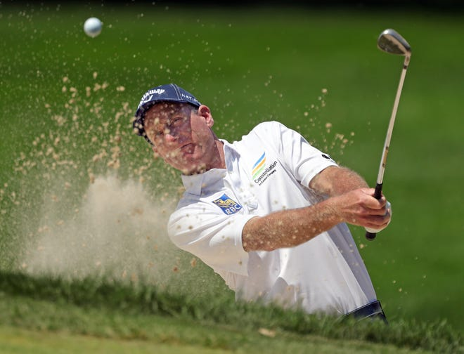 Jim Furyk eyes down his bunker shot on No. 4 during the final round of the Bridgestone Senior Players Championship at Firestone Country Club on Sunday. [Jeff Lange/Beacon Journal]