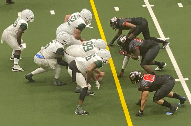 Tolon Avery (middle), Byron Cooper (top), and Cody Gilchrist (bottom) line up on the defensive line of Saturday's 44-21 victory over the Texas Jets.