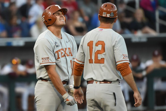 Texas designated hitter Ivan Melendez winces in pain after getting hit by a pitch in the ninth inning of Saturday night's 4-3 loss to Mississippi State. Melendez was the hero of Friday night's win over the Bulldogs when he hit a three-run home run.