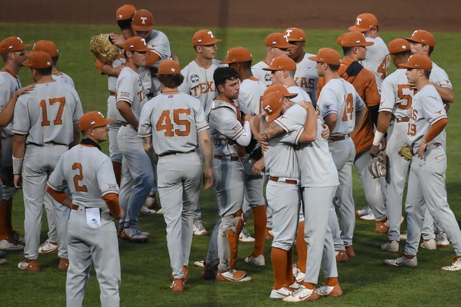 Texas players console one another after Saturday night's 4-3 loss to Mississippi State ended their season at the College World Series. The Longhorns, who won the Big 12 championship, were 50-17 this year.