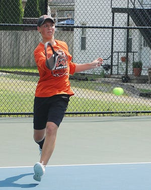 Ryan Frazee returns a shot during the Times-Gazette Tennis Open Saturday at the Brookside Park tennis courts.