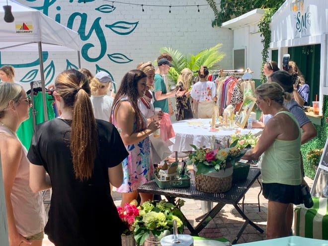 Dozens of shoppers enjoy the goods and services provided by the women-owned businesses at Augusta Girl Gang's first Summer Mart at Sugar Magnolias on Reynolds Street in Augusta, GA, on June 27, 2021.