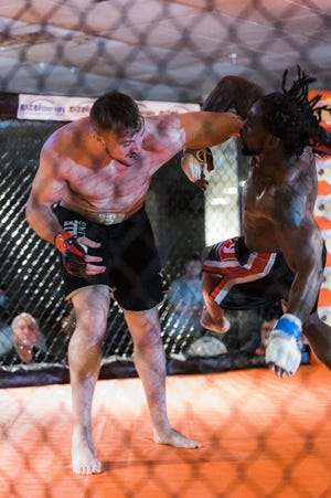 Justin Budd flings Sylvester Moore wildly across the cage in Justin title defense match at the Bartlesville Beatdown on Saturday Night.