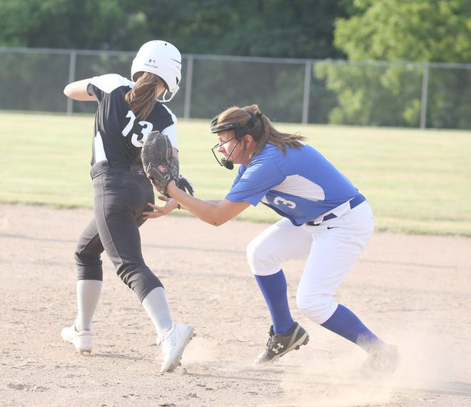 Jamestown second baseman Madelyn Gerlach applies the tag on Workshop Wonders player Tatum Hoover in Babe Ruth 16Usoftball Wednesday night at Bill Simmons field at Rolling Hills park.