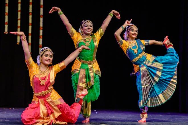 From left, Saatvika Nistala, Meenakshi Sivaraman and Prathyankara Premkumar start their Bharatanatyam Arangetram dance performance Saturday at Battle High School.