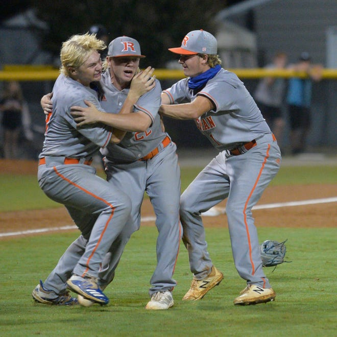 Randleman pitcher Ryan White is greeted by teammates Drake Purvis (left) and Hunter Atkins (right) moments after completing his no-hitter. [Mike Duprez/Courier-Tribune]