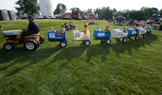 Children were given tractor rides at the Firemen's Festival on Saturday.