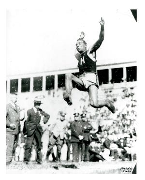 Jacksonville native Edward Orval (Ned) Gourdin launches a long jump with Harvard University. Gourdin became the first man in world history to surpass 25 feet in the long jump on July 23, 1921.