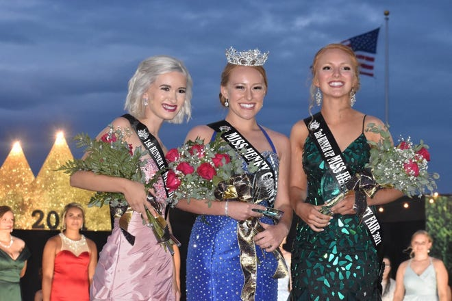 Katie Noyd, center, is the new Miss Henry County Fair. She was chosen on Tuesday, June 22, when rain couldn't dampen her smile. Bradleigh Schaefer, left, is first runner up and Taylor Burke, right, the second runner up.