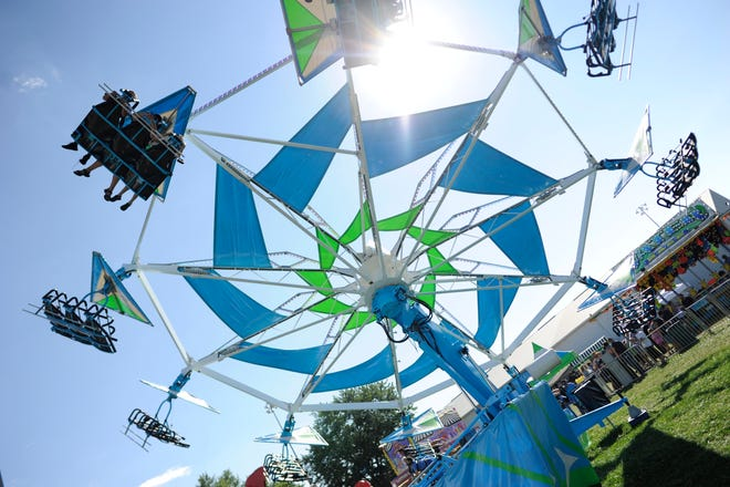 The Hang Glider ride is seen at the 2018 Monroe County Fair. This year's fair opens Monday at the fairgrounds southwest of Bloomington, with carnival rides starting Tuesday evening.