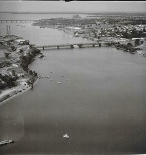 A Herald News reader sent Charley Soares this 1972 aerial photo of the Taunton River which captures the Braga Bridge, the Brightman Street Bridge and, immediately to the left, the Weetamoe Yacht Club. Heading north down the left shoreline are the docks going out from Pete Pelletier's boat house, then in the lower left the shallow cove where people waded or hunted blue shell crabs. The pier in the extreme lower left hand corner was where Paddy Conners had his brick house and boat rental business. What else do Herald News readers have?