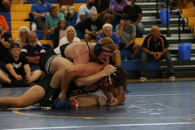 North Henderson High graduate Triston Norris, top, competes in the 3-A state semifinal 220-pound match on June 26 in Gibsonville. He won the match and went on to win his first state title.  [DEAN HENSLEY/ TIMES-NEWS]