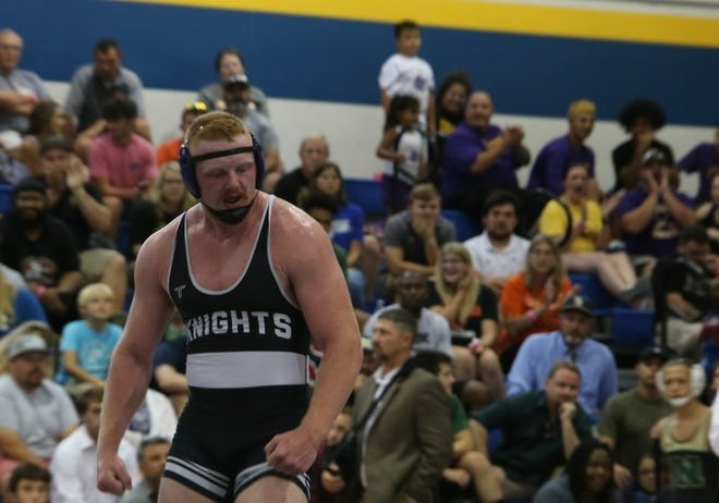 North Henderson High graduate Triston Norris celebrates his 3-A state title win on June 26 at Eastern Guilford High School in Gibsonville. [DEAN HENSLEY/ TIMES-NEWS]