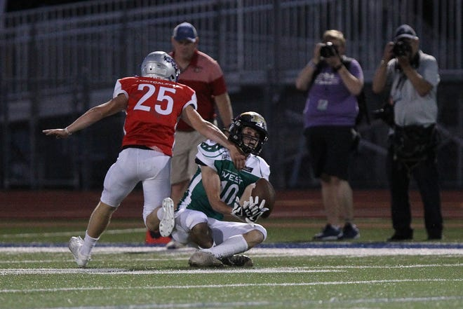 West's Jayden Garrison (20) from Little River just misses the catch against East's Thad Metcalfe (25) from Perry-Lecompton during the 2021 Kansas Shrine Bowl game at Gowans Stadium in Hutchinson Saturday night. The West squad defeated the East squad 14-0.