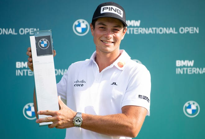 Viktor Hovlandposes with the trophy after winning the European Tour International Open on Sunday in Moosinning, Germany.