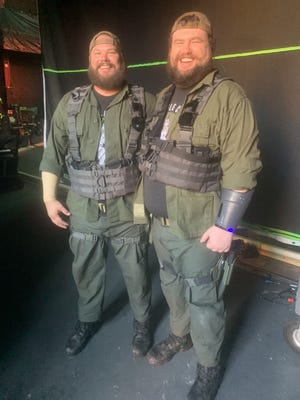 """Quincy native Mike Mitchell stands with his stuntman while filming """"The war of tomorrow."""""""