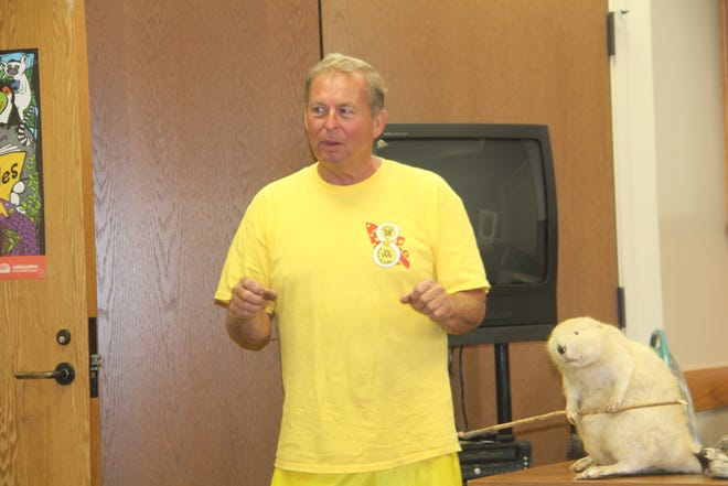 """Outdoorsman Bruce Hendren talks June 23 to a Summer Reading Program audience at the Pawhuska Library. The theme for Summer Reading 2021 is """"Trails, Tails and Tales."""" Hendren, who is shown with the preserved remains of a beaver, shared stories and advice with children and their parents about wild animals."""