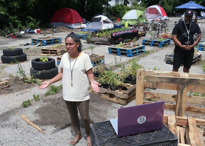 Diumila Almonte speaks for the tent community living on Wilson Street in Providence earlier this month.