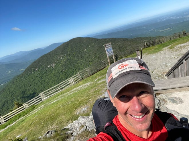 In trying to break the record for traversing Vermont's Long Trail, Jeremy Howard of Little Compton has raised more than $10,000 for The Play Brigade, a Boston-based nonprofit.