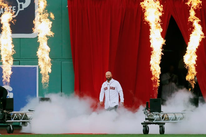 Retired Red Sox second baseman Dustin Pedroia enters Fenway Park for ceremonies honoring him on Friday night.