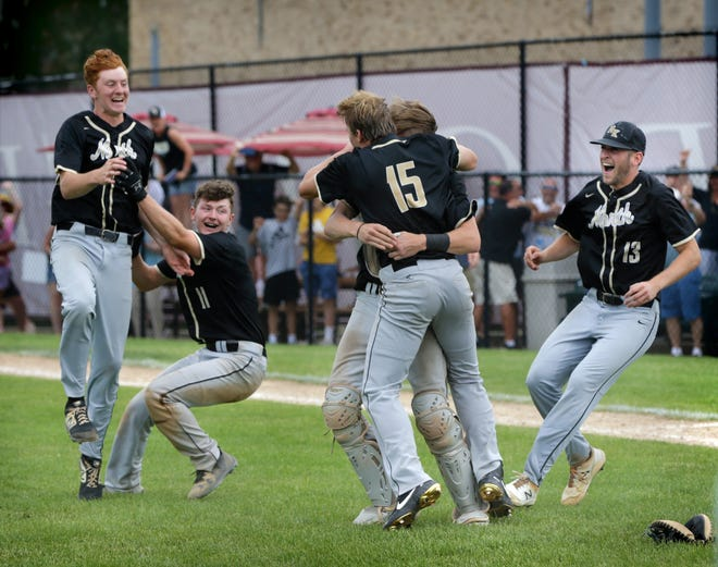 Members of the North Kingstown baseball team — including Evan Maloney, Wyatt Daft, catcher Josh Lincourt, pitcher TJ Gormley (15) and Noah Quarella— rush the pitching mound after they defeated Coventry, 8-3, for the state championship on Sunday afternoon.