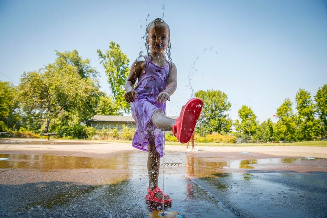Emma Clark, 5, kicks water while escaping from the record-breaking heat at the Washington Park Spray Play feature on June 27. The temperature in Eugene reached 111 on June 27, the city's highest recorded temperature.