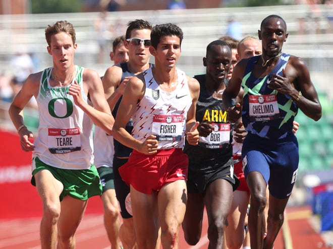 Oregon's Copper Teare, left, makes a move to the outside on the last lap of the men's 10,000 meters behind Paul Chelimo, right, and Grant Fisher, center, at the U.S. Olympic Track and Field Trials on Sunday at Hayward Field.
