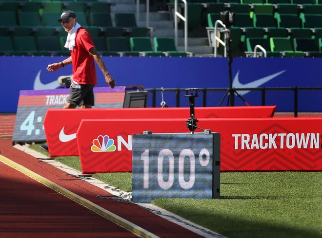 A readerboard flashes 100 degrees as crews set up for the afternoon events at Hayward Field during the U.S. Olympic Track and Field Trials Saturday in Eugene.