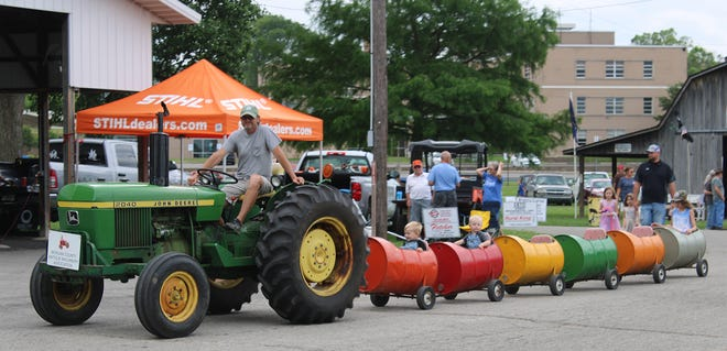 Children go for a ride at this weekend's Morgan County Antique Machinery Show.